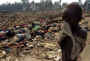 File photo of a Rwandan boy covering his face from the stench of dead bodies