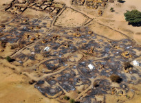 An overhead view of the remains of the burned-out village of Abu Sourouj, which was bombed on the 8 February by the Sudanese government and simultaneously attacked by armed men on camels, horseback and donkeys, otherwise known as Janjaweed, in West Darfur, Sudan, February 28, 2008.  The government spate of bombings was in response to an ambush two months prior by rebels from the Justice and Equality Movement, and subsequent intelligence that JEM members were living in these villages and using them as a base. After a period of relative quiet, there has been a great deal of renewed fighting between the Sudanese government with militias loyal to the government and rebel factions, namely JEM. Dozens of civilians in Silean, Sirba, and Abu Sourouj were killed in the attacks around February 8-9th,many others were injured, and a large percentage of each of the three villages was burned to the ground.  (Credit: Lynsey Addario for The New York Times)